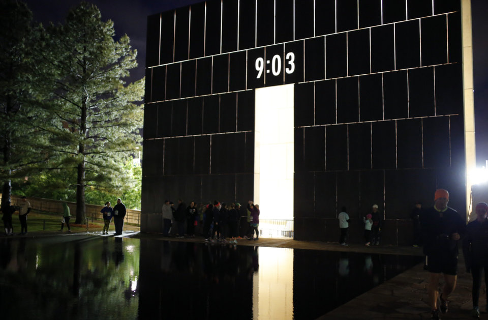 Photo - The Oklahoma City National Memorial & Museum is pictued at the Survivor Tree during the Sunrise Service before the 2017 Oklahoma City Memorial Marathon Sunday, April 30, 2017.  Photo by Sarah Phipps, The Oklahoman