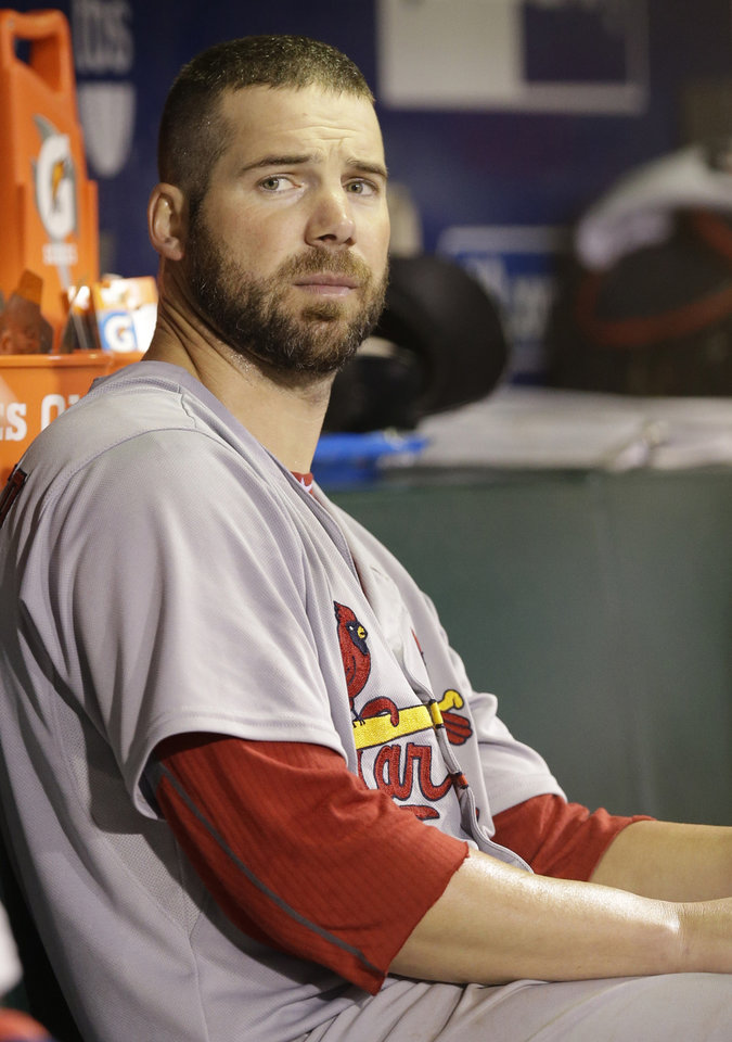Photo - FILE - In this Oct. 15, 2012, file photo, St. Louis Cardinals starting pitcher Chris Carpenter sits in the dugout after being taken out of the game during the fifth inning of Game 2 of baseball's National League championship series against the San Francisco Giants in San Francisco. Carpenter is unlikely to pitch for the Cardinals this season and his career may be over because of a nerve injury that kept him out most of last year, general manager John Mozeliak said Tuesday, Feb. 5, 2013. (AP Photo/David J. Phillip, File)