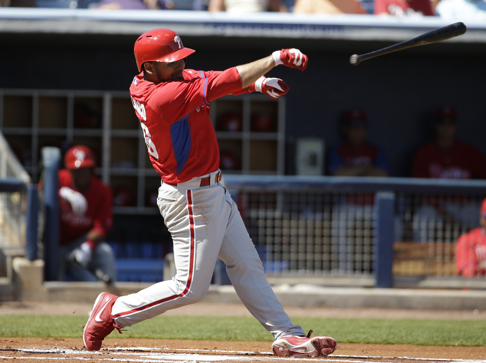 Photo - Philadelphia Phillies' Andres Blanco loses the bat on a pitch from Tampa Bay Rays' Matt Moore in the first inning of an exhibition baseball game, Monday, March 3, 2014, in Port Charlotte, Fla. (AP Photo/Steven Senne)