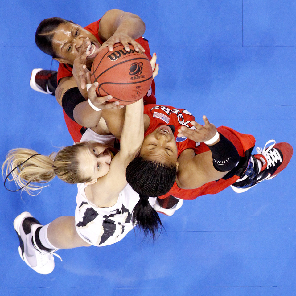 Purdue's Natasha Bogdanova tries to grab rebound between Rutgers' Kia Vaughn, left, and Khadijah Rushdan during the NCAA women's basketball tournament game between Rutgers and Purdue at the Ford Center in Oklahoma City, Sunday, March 29, 2009.  PHOTO BY BRYAN TERRY, THE OKLAHOMAN