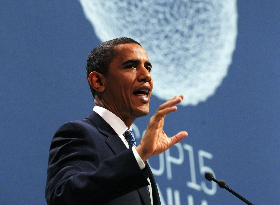 Photo -   FILE - In this Dec. 18, 2009 file photo, President Barack Obama speaks at the morning plenary session of the United Nations Climate Change Conference in Copenhagen, Denmark. Obama proposed a bill that would have capped power plant carbon dioxide emissions and allowed trading of credits for the right to emit greenhouse gases, but the measure subsequently died in Congress, and his international treaty effort failed. He has since taken a different approach, treating carbon dioxide as a pollutant under the law. (AP Photo/Susan Walsh, File)