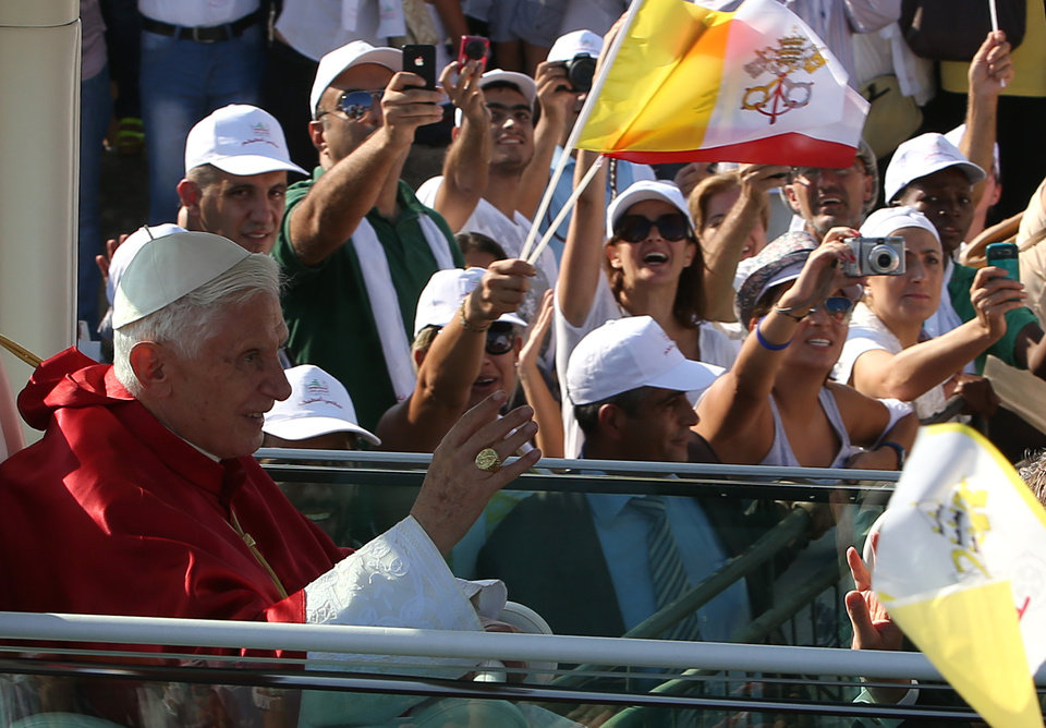 Photo -   Pope Benedict XVI, waves to Lebanese faithful from his popemobile on arrival to held mass on the waterfront in downtown Beirut, Lebanon, Sunday Sept. 16, 2012. The Pope celebrated an open-air mass for tens of thousands of pilgrims from across the Middle East, saying Christians must do their part to end the