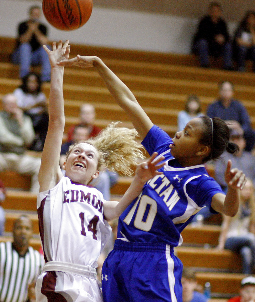 Edmond Memorial's Alyssa Hand, left, puts up a shot beside Choctaw's Sydney Wyatt during the Class 6A girls basketball regional championship game at Edmond Memorial High School, Saturday, Feb. 25, 2012. Photo By Bryan Terry, The Oklahoman