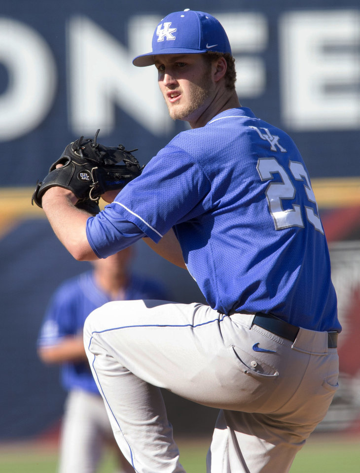 Photo - Kentucky's Kyle Cody pitches against Florida during the Southeastern Conference NCAA college baseball tournament Wednesday, May 21, 2014, in Hoover, Ala. (AP Photo/Hal Yeager)