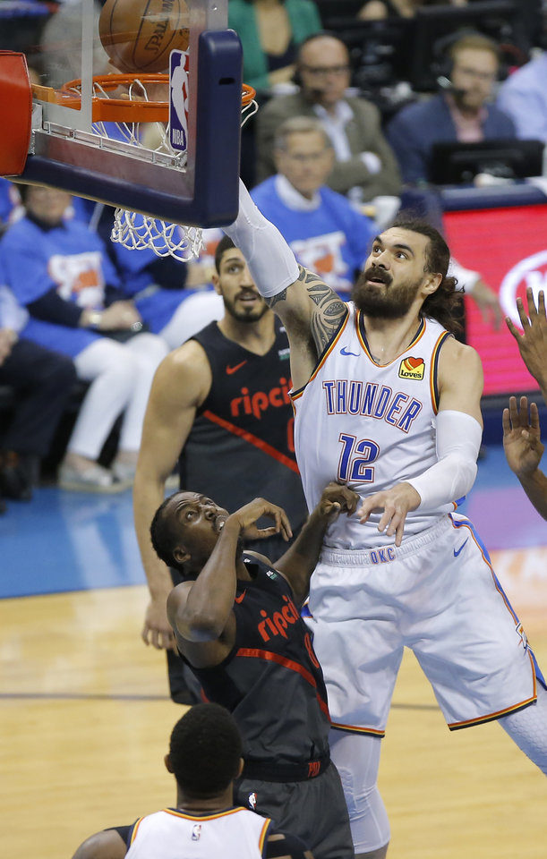 Photo - Oklahoma City's Steven Adams (12) gors to the basket beside Portland's Al-Farouq Aminu (8) during Game 4 in the first round of the NBA playoffs between the Portland Trail Blazers and the Oklahoma City Thunder at Chesapeake Energy Arena in Oklahoma City, Sunday, April 21, 2019. Photo by Bryan Terry, The Oklahoman