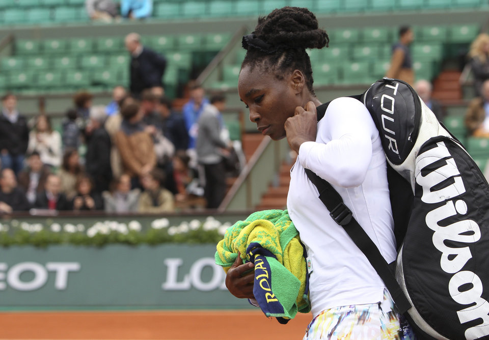 Photo - Venus Williams of the U.S. leaves after losing her second round match of the French Open tennis tournament in three sets against Slovakia's Anna Schmiedlova at the Roland Garros stadium, in Paris, France, Wednesday, May 28, 2014. (AP Photo/David Vincent)