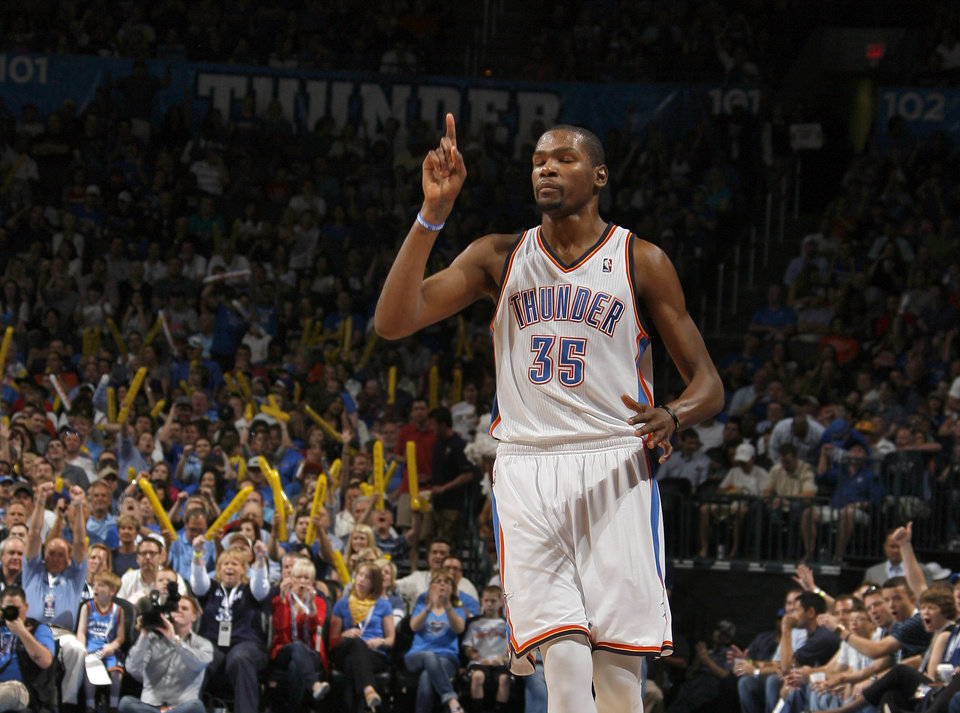Oklahoma City's Kevin Durant (35) celebrates a three-point shot during the NBA basketball game between the Chicago Bulls and the Oklahoma City Thunder at Chesapeake Energy Arena in Oklahoma City, Sunday, April 1, 2012. Photo by Sarah Phipps, The Oklahoman