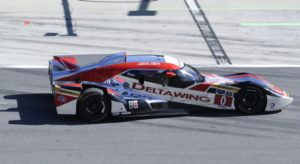 Photo - Andy Meyrick, of England, drives the DeltaWing DWC13 down pit road before the start of the IMSA Series Rolex 24 hour auto race at Daytona International Speedway in Daytona Beach, Fla., Saturday, Jan. 25, 2014.(AP Photo/John Raoux)