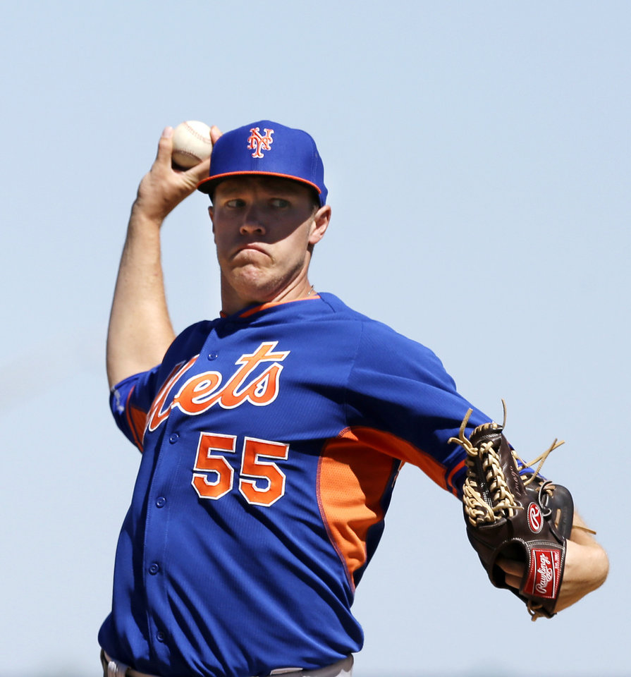 Photo - New York Mets starting pitcher Noah Syndergaard warms up during the second inning of an exhibition baseball game against the Detroit Tigers in Lakeland, Fla., Saturday, March 8, 2014. (AP Photo/Carlos Osorio)
