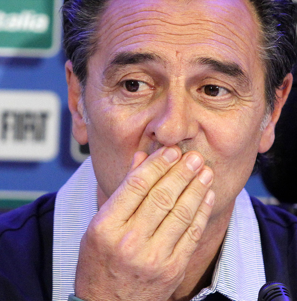 Photo - Italy coach Cesare Prandelli listens reporters' questions during a press conference at Coverciano training complex, in Florence, Italy, Tuesday, May 20 , 2014,   Italy opened its World Cup training camp Monday with 31 players.  Prandelli needs to trim his squad to 23 players by June 2.  In Brazil, Italy is in Group D with England, Uruguay and Costa Rica. (AP Photo/Fabrizio Giovannozzi)