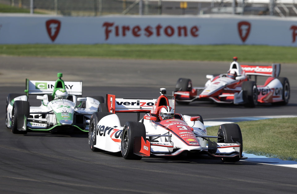 Photo - Helio Castroneves, of Brazil, (3) leads Carlos Munoz, of Bogota, left, and Juan Pablo Montoya, of Colombia, through turn 2 during practice for the inaugural Grand Prix of Indianapolis IndyCar auto race at the Indianapolis Motor Speedway in Indianapolis, Thursday, May 8, 2014. (AP Photo/Michael Conroy)