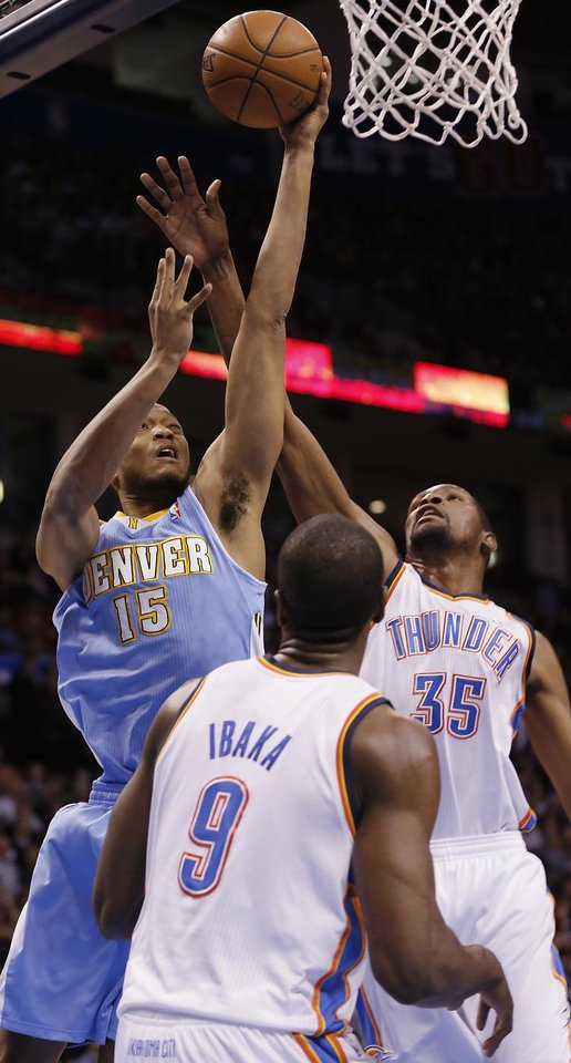 Denver\'s Anthony Randolph (15) drives against Oklahoma City\'s Kevin Durant (35) and Serge Ibaka (9) during the NBA basketball game between the Oklahoma City Thunder and the Denver Nuggets at the Chesapeake Energy Arena on Wednesday, Jan. 16, 2013, in Oklahoma City, Okla. Photo by Chris Landsberger, The Oklahoman