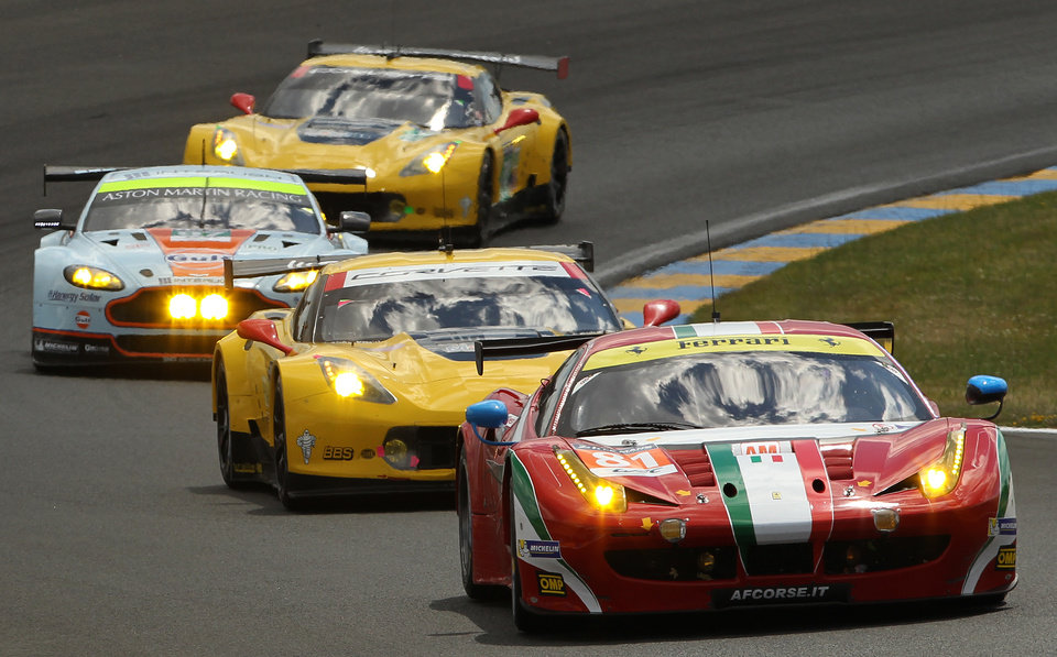 Photo - The Ferrari 458 Italia, front, driven by Britain's Sam Bird, Italy's Michele Rugolo and Australia's Stepan Wyatt during the 82nd 24-hour Le Mans endurance race, in Le Mans, western France, Saturday, June 14, 2014. (AP Photo/Bob Edme)