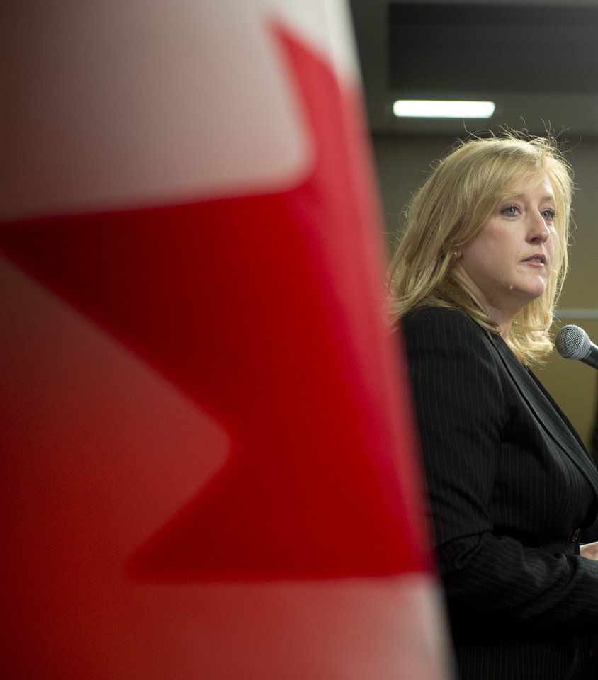Photo - Transport Minister Lisa Raitt announces new railway safety measures during a news conference on Wednesday, April 23, 2014 in Ottawa, Ontario.  Raitt announced that the DOT-111 tankers, which are used to carry crude oil and ethanol and are prone to rupture, must be retired or retrofitted within three years. (AP Photo/The Canadian Press, Adrian Wyld)