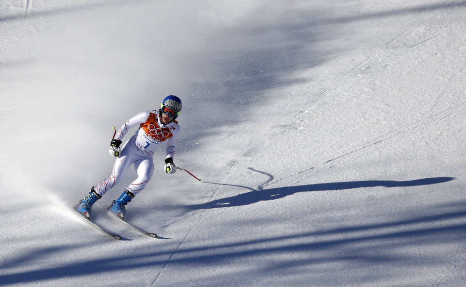 Photo - United States' Laurenne Ross comes to a halt  in the finish area after a women's downhill training run for the Sochi 2014 Winter Olympics, Thursday, Feb. 6, 2014, in Krasnaya Polyana, Russia. (AP Photo/Christophe Ena)