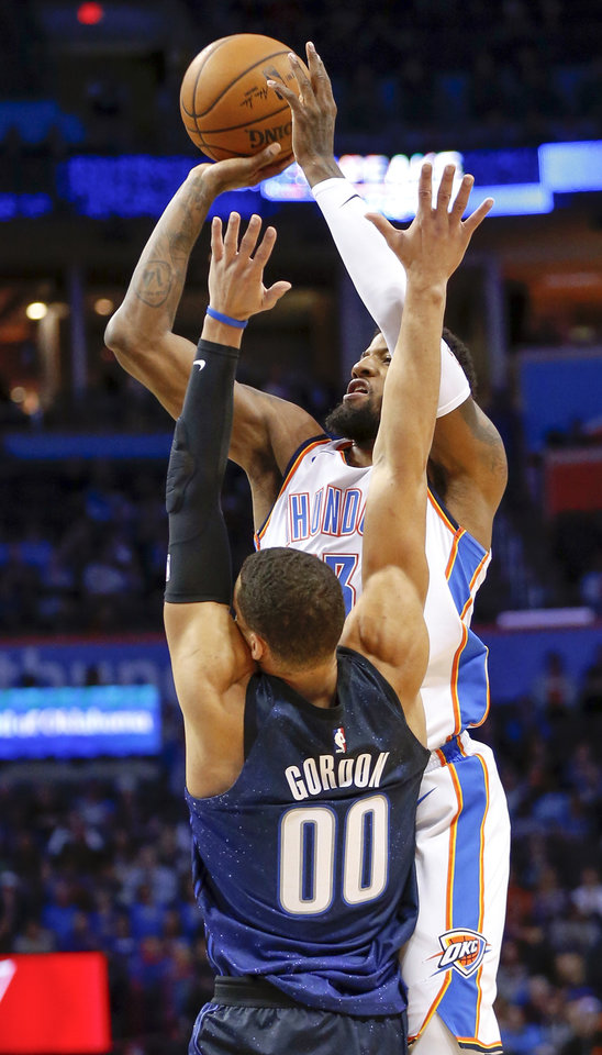 Photo - Oklahoma City's Paul George (13) shoots against Orlando's Aaron Gordon (00) during an NBA basketball game between the Oklahoma City Thunder and the Orlando Magic at Chesapeake Energy Arena in Oklahoma City, Monday, Feb. 26, 2018. Photo by Nate Billings, The Oklahoman