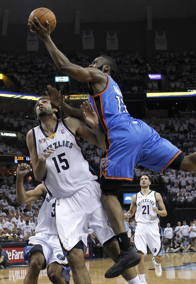Photo - Oklahoma City Thunder guard James Harden (13) drives against Memphis Grizzlies center Hamed Haddadi (15), of Iran, during the first half of Game 4 of a second-round NBA basketball playoff series on Monday, May 9, 2011, in Memphis, Tenn. (AP Photo/Lance Murphey)