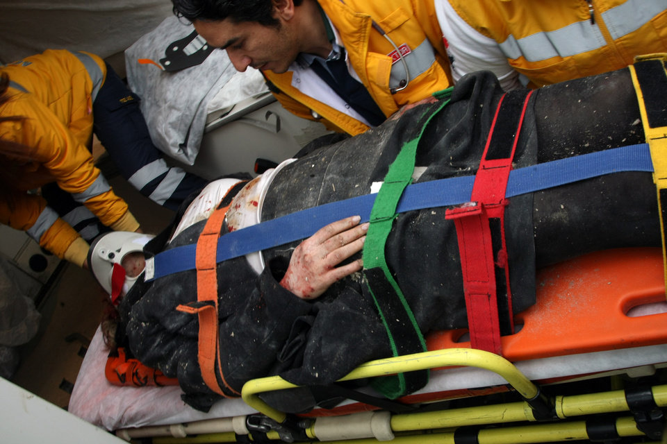 Photo - Medics and firefighters carry an injured woman on a stretcher to an ambulances after a suicide bomber had detonated an explosive device at the entrance of the U.S. Embassy in the Turkish capital, Ankara, Turkey, Friday, Feb. 1, 2013. A suspected suicide bomber detonated an explosive device at the entrance of the U.S. Embassy in the Turkish capital on Friday, killing himself and one other person, officials said.  (AP Photo/Burhan Ozbilici)