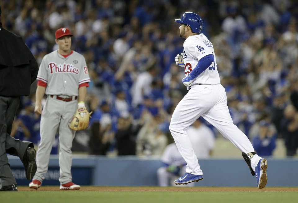 Photo - Los Angeles Dodgers' Adrian Gonzalez, right, rounds the bases after hitting a home run as Philadelphia Phillies third baseman Cody Asche watches during the seventh inning of a baseball game on Thursday, April 24, 2014, in Los Angeles. (AP Photo/Jae C. Hong)