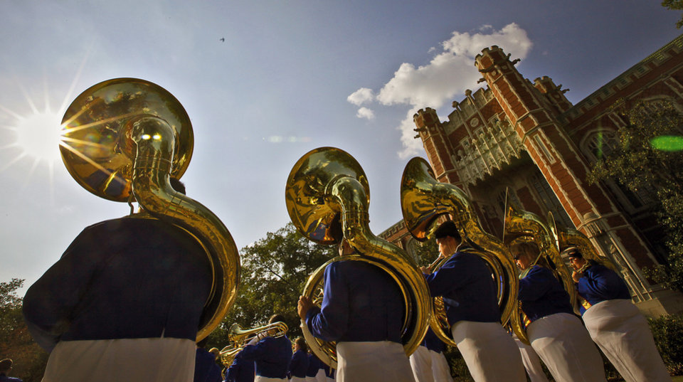 Photo - The Tulsa band warms up outside the Price Business School before the start of the college football game between the University of Oklahoma Sooners (OU) and the Tulsa University Hurricanes (TU) at the Gaylord Family-Memorial Stadium on Saturday, Sept. 3, 2011, in Norman, Okla. 