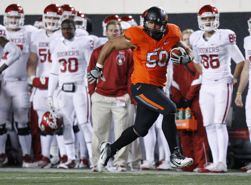 Oklahoma State\'s Jamie Blatnick (50) runs after a fumble during the Bedlam college football game between the Oklahoma State University Cowboys (OSU) and the University of Oklahoma Sooners (OU) at Boone Pickens Stadium in Stillwater, Okla., Saturday, Dec. 3, 2011. Photo by Bryan Terry, The Oklahoman