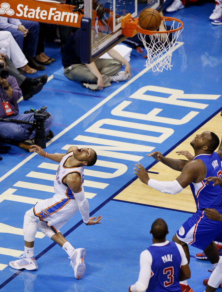 Photo - Russell Westbrook (0) bends over backwards to watch his shot drop in during Game 5 of the Western Conference semifinals in the NBA playoffs between the Oklahoma City Thunder and the Los Angeles Clippers at Chesapeake Energy Arena in Oklahoma City,  Tuesday, May 13, 2014. Photo by Bryan Terry, The Oklahoman