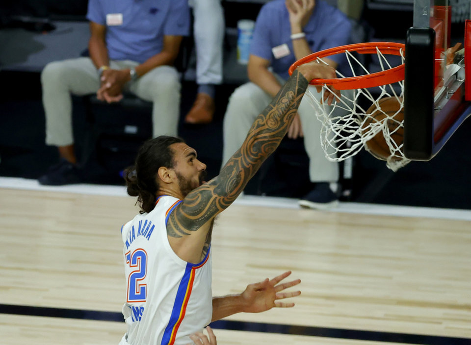 Photo - Oklahoma City Thunder's Steven Adams dunks the ball against the Los Angeles Lakers during the first half of an NBA basketball game Wednesday, Aug. 5, 2020, in Lake Buena Vista, Fla. (Kevin C. Cox/Pool Photo via AP)