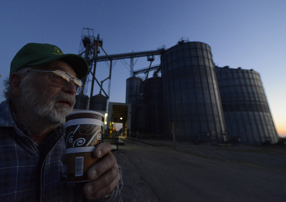 Sipping from a coffee cup, farmer Jim Overly from Utica, Ohio waits for the Coshocton Grain Co. facility in Hebron, Ohio to open Tuesday, Nov. 6, 2012. Overly said he was going to vote when the polls opened after unloading his corn, adding he felt it didn\'t make alot of difference who won the presidency, but