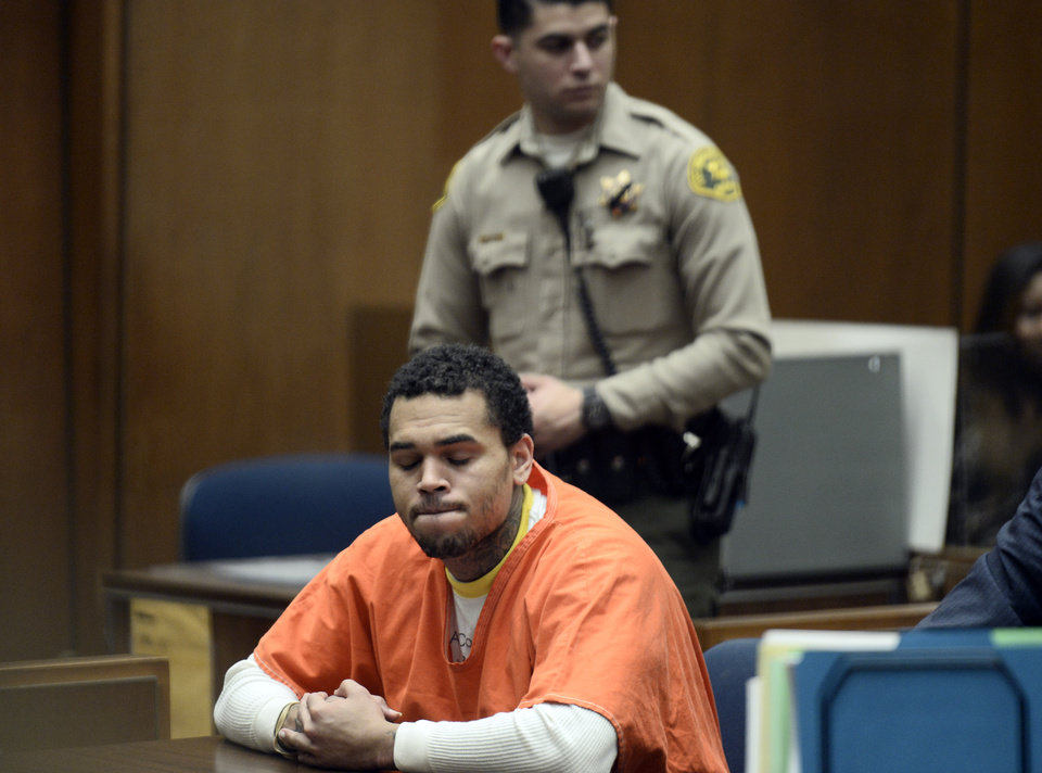 Photo - Chris Brown, appears in court Friday May 9, 2014 in Los Angeles. Brown on Friday admitted a probation violation over an altercation last year outside a hotel in Washington, D.C., and was sentenced to remain on probation and serve an additional 131 days in jail. (AP Photo/Paul Buck, POOL)