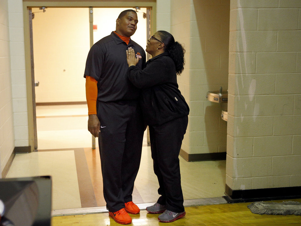 Photo - Dorshell Clark talks with Douglass football coach Willis Alexander during her son's, Deondre Clark's, basketball game at Douglass High School in Oklahoma City, Tuesday, January 28, 2014. Photo by Bryan Terry, The Oklahoman