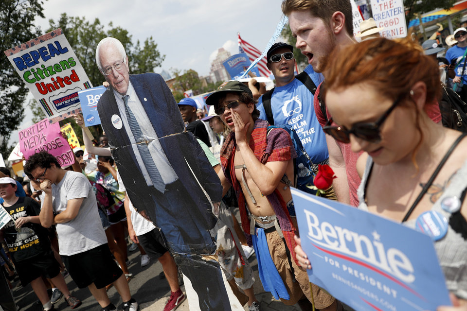 Photo - Supporters of Sen. Bernie Sanders, I-Vt., march during a protest in downtown on, Monday, July 25, 2016, in Philadelphia, during the first day of the Democratic National Convention. (AP Photo/John Minchillo)
