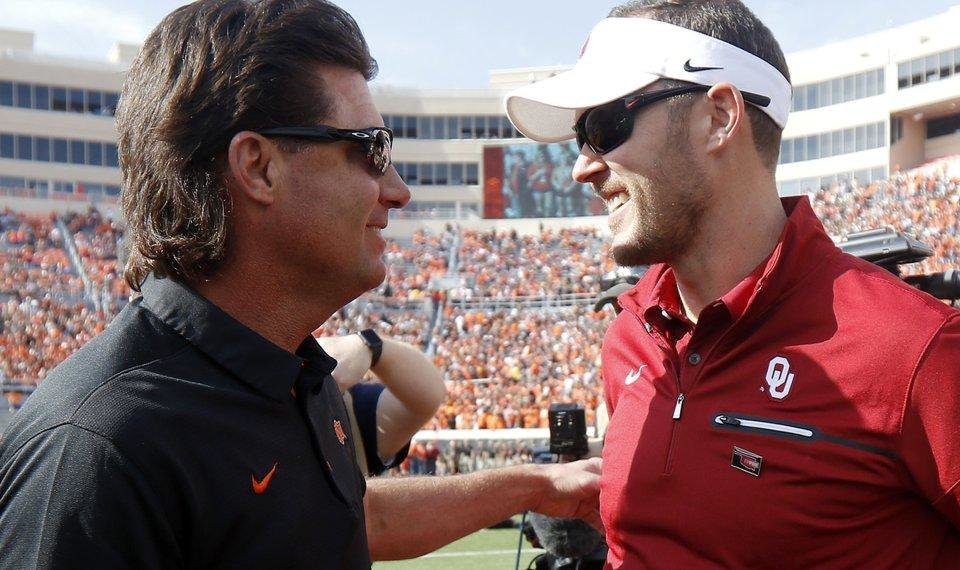 Photo - Oklahoma State coach Mike Gundy and Oklahoma coach Lincoln Riley talk before the Bedlam college football game between the Oklahoma State Cowboys (OSU) and the Oklahoma Sooners (OU) at Boone Pickens Stadium in Stillwater, Okla., Friday, Nov. 3, 2017. Oklahoma won 62-52. Photo by Bryan Terry, The Oklahoman