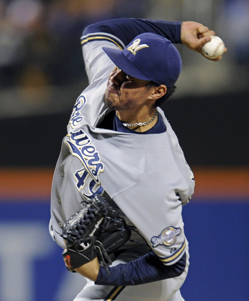Photo - Milwaukee Brewers pitcher Yovani Gallardo delivers the ball to the New York Mets during the first inning of a baseball game Friday, Sept. 27, 2013, in New York. (AP Photo/Bill Kostroun)