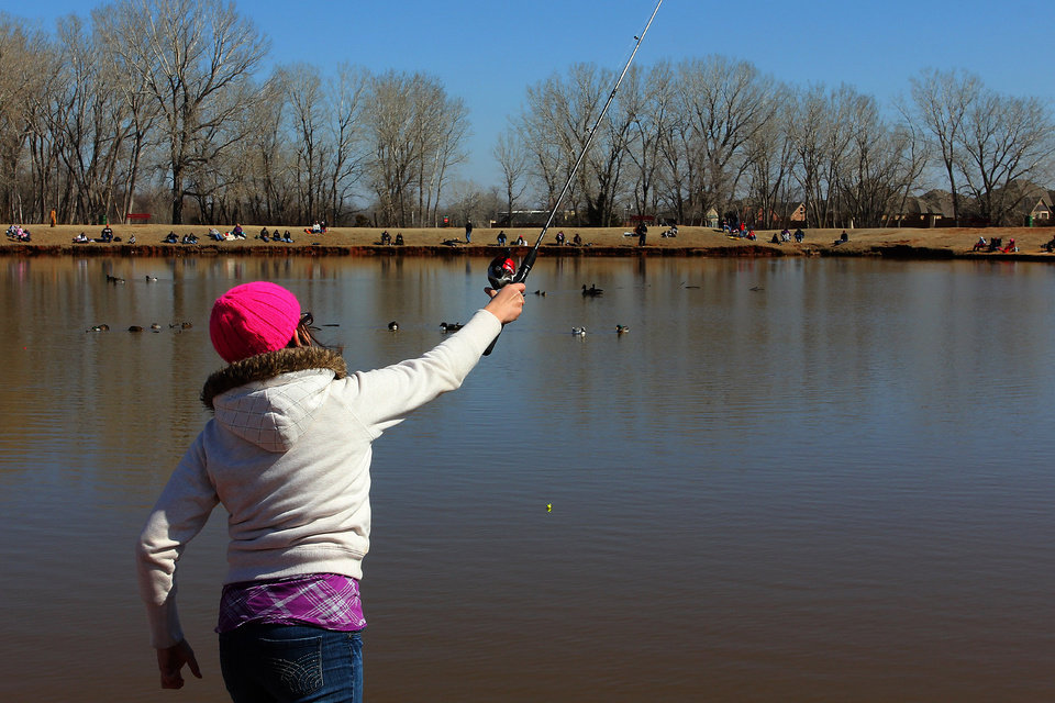 Kelsea McFadden, 11, of Yukon casts her line into the water during the Trout Fish Out Saturday, March 2, 2013,  morning at the Dale Robertson Activity Center pond in Yukon. PHOTO BY HUGH SCOTT FOR THE OKLAHOMAN