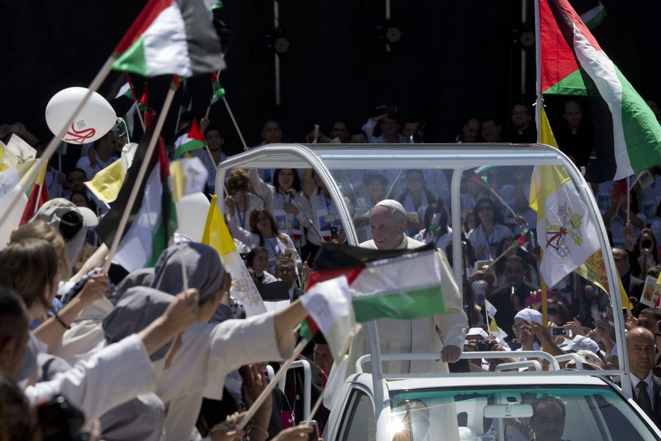 Photo - Pope Francis arrives to celebrate mass in Manger Square next to the Church of the Nativity, believed by many to be the birthplace of Jesus Christ, in the West Bank city of Bethlehem, Sunday, May 25, 2014. (AP Photo/Andrew Medichini, Pool)