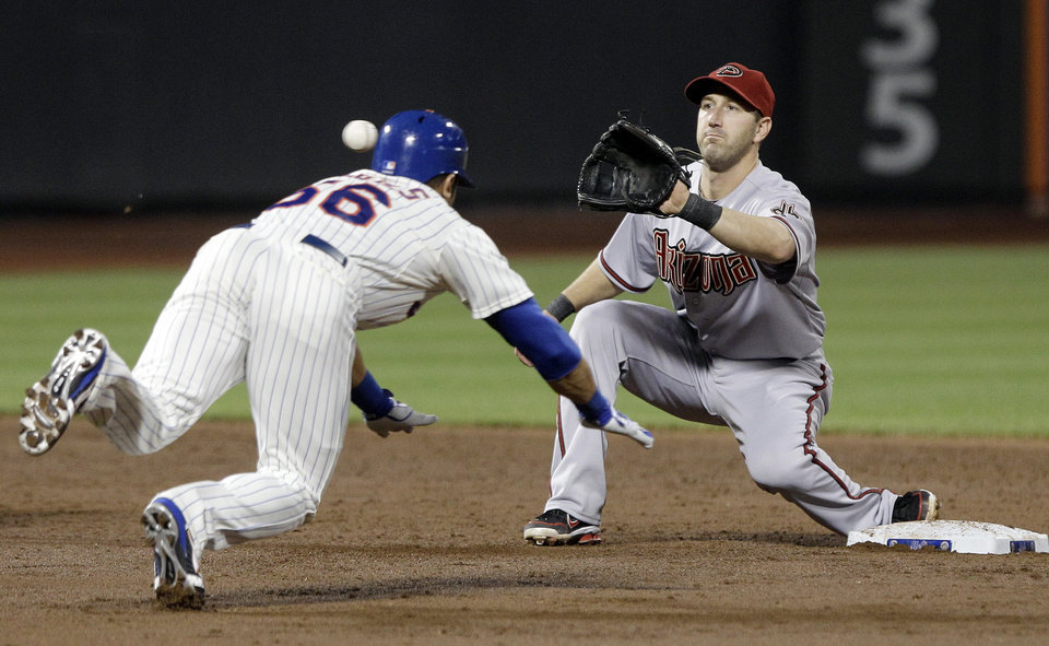 Photo -   New York Mets' Andres Torres, left, attempts to beat the throw to second base as Arizona Diamondbacks' Willie Bloomquist (18) waits for the ball of a baseball game during the third inning, Friday, May 4, 2012, in New York. Torres was out on the play. (AP Photo/Frank Franklin II)