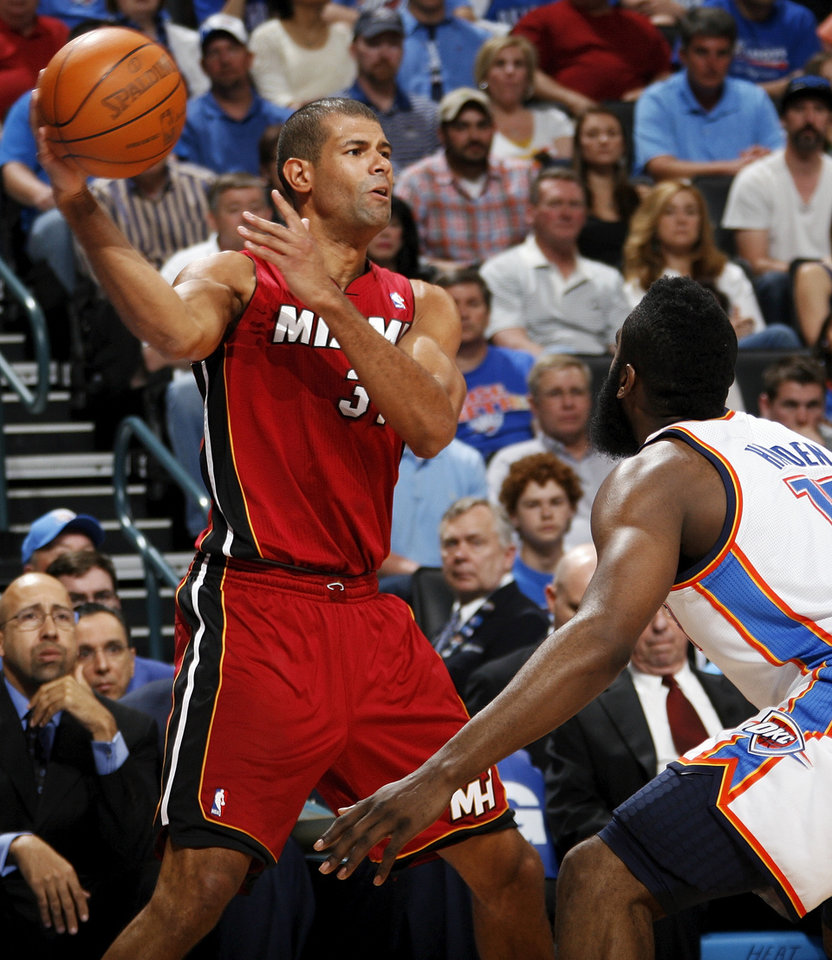 Miami's Shane Battier (31) passes the ball as Oklahoma City's James Harden (13) defends during the NBA basketball game between the Miami Heat and the Oklahoma City Thunder at Chesapeake Energy Arena in Oklahoma City, Sunday, March 25, 2012. Photo by Nate Billings, The Oklahoman