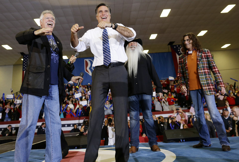 Photo -   Republican presidential candidate and former Massachusetts Gov. Mitt Romney stands on stage with The Oak Ridge Boys as he campaigns at the Veterans Memorial Coliseum, Marion County Fairgrounds, in Marion, Ohio, Sunday, Oct. 28, 2012. (AP Photo/Charles Dharapak)