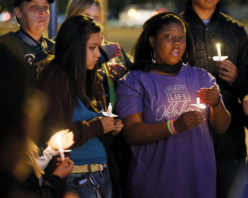 Diamond Asberry, right, sister of Kittrick Johnson Jr., speaks during a candlelight vigil Wednesday in Midwest City. Six of Johnson's organs were donated to people in need of lifesaving transplants after the 17-year-old died in a motorcycle wreck last week. The Midwest City High School student was wearing a helmet and safety gear but suffered third-degree burns over half of his body. His family held the vigil to raise awareness of organ donation. Read more on Page 13A. Photo by Nate Billings, The Oklahoman