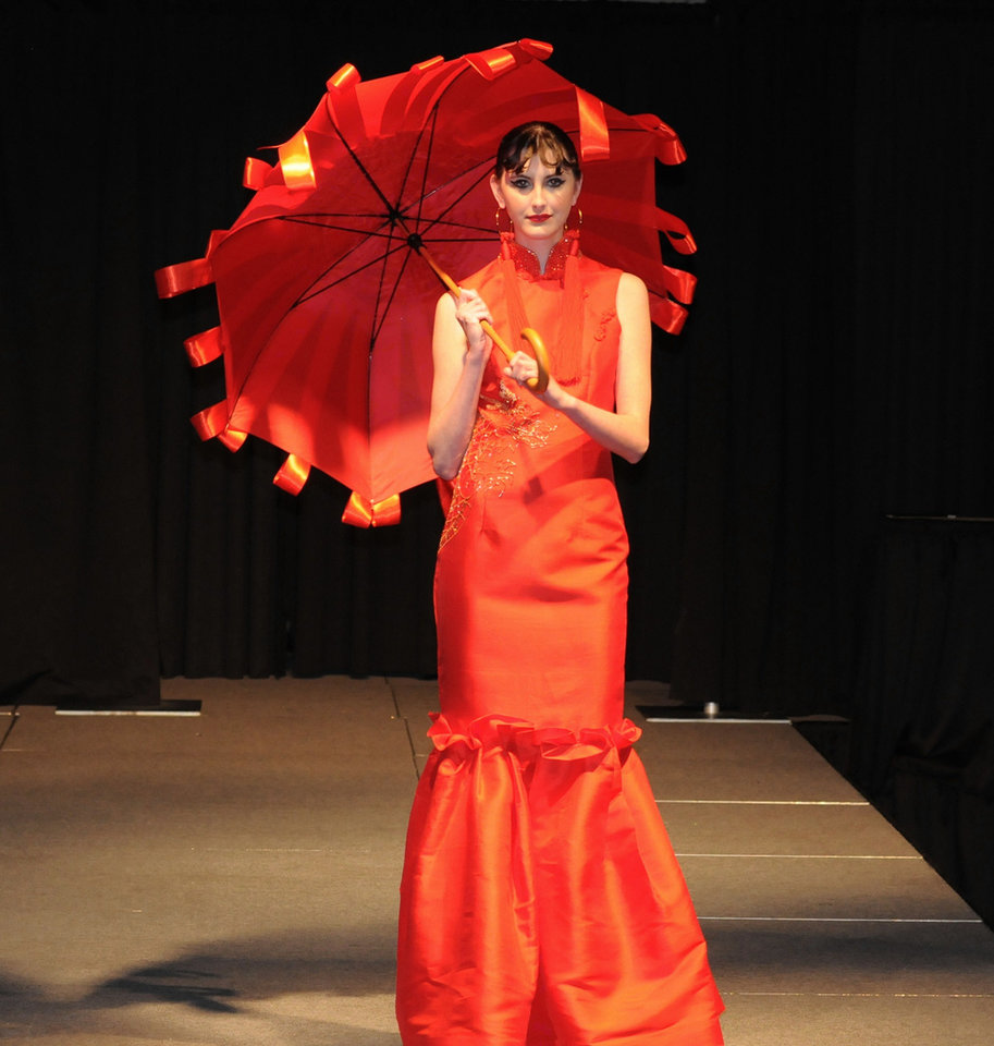 Photo - For the Oriental Evening category of the 2010 Dallas Designers Display Competition, Thomas designed this red Thai silk gown with a beaded dragon along the side and back. Photo provided.