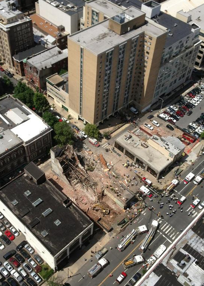 Photo - This photo provided by Russell Krause shows  the scene of a building collapse on the edge of downtown Philadelphia on Wednesday June 5, 2013. The four-story building being demolished collapsed, injuring 12 people and trapping two others, the fire commissioner said. Rescue crews were trying to extricate the two people who were trapped, city Fire Commissioner Lloyd Ayers said. The dozen people who were injured were taken to hospitals with minor injuries, he said.(AP Photo/Russell Krause)
