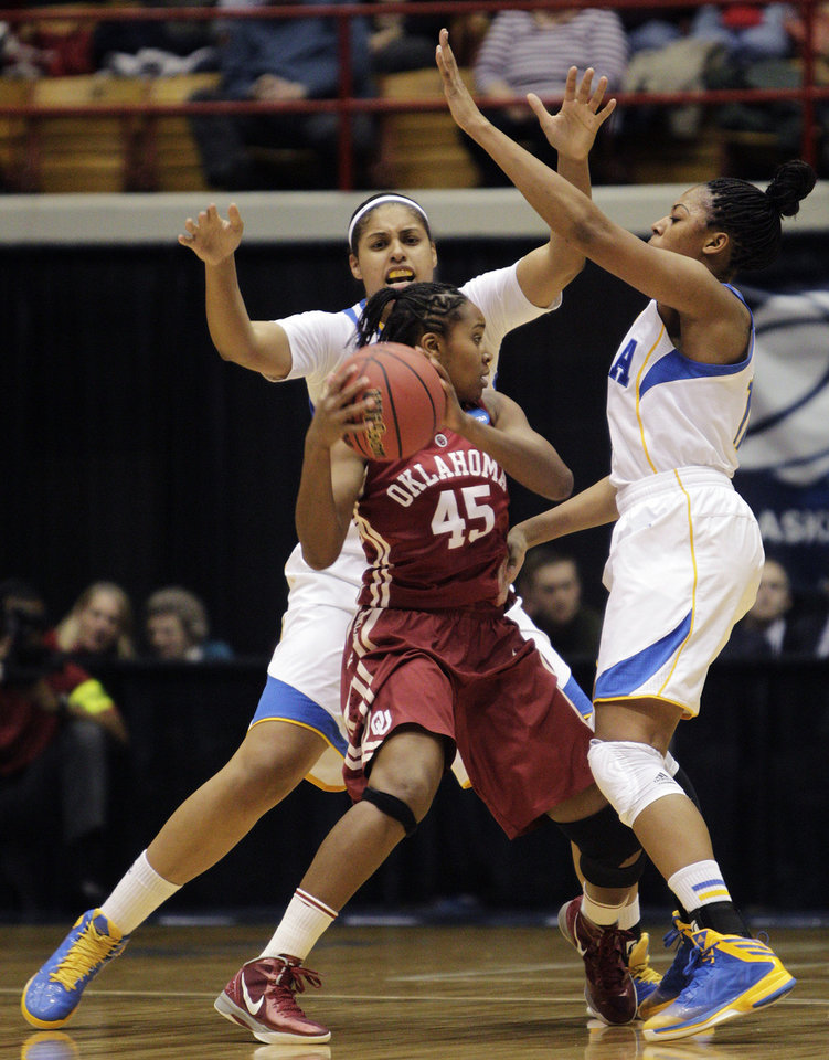 UCLA's Alyssia Brewer, left, and Atonye Nyingifa trap Oklahoma's Jasmine Hartman during the first half of a second-round game in the women's NCAA college basketball tournament, Monday, March 25, 2013, in Columbus, Ohio. (AP Photo/Jay LaPrete) ORG XMIT: OHJL101