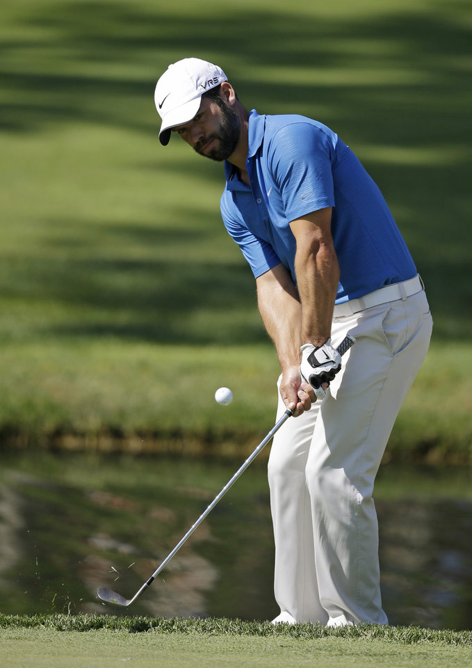 Photo - Paul Casey chips to the ninth green during the second round of the Memorial golf tournament on Friday, May 30, 2014, in Dublin, Ohio. (AP Photo/Darron Cummings)