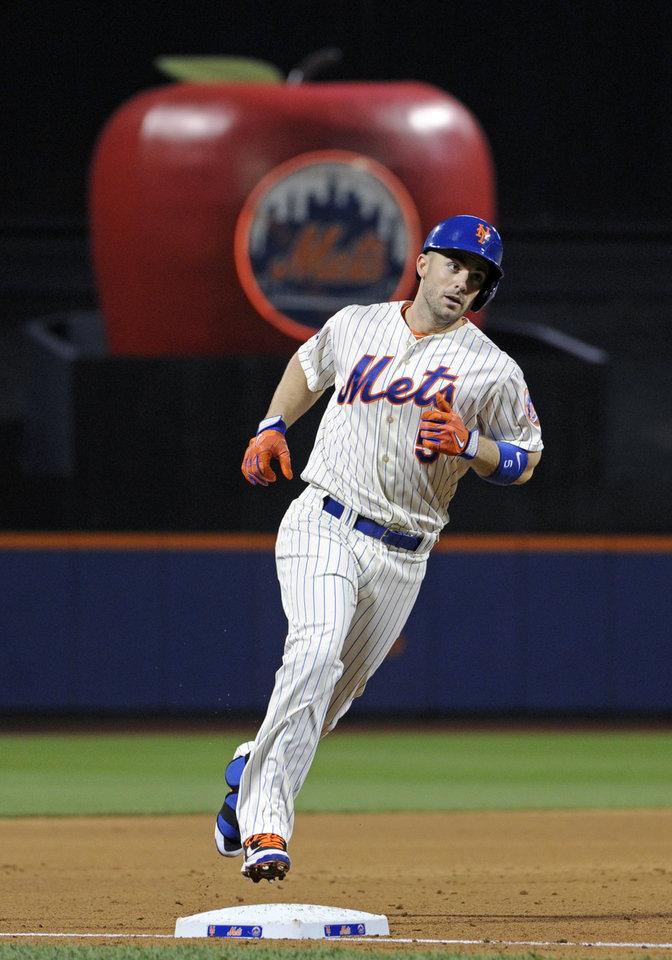 Photo - New York Mets' David Wright rounds third with a two-run home run during the first inning of a baseball game against the Philadelphia Phillies, Saturday, May 10, 2014, at Citi Field in New York. (AP Photo/Bill Kostroun)