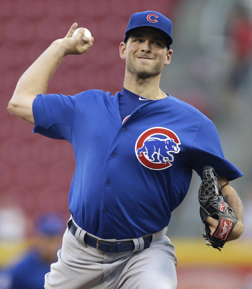 Photo - Chicago Cubs starting pitcher Jacob Turner throws against the Cincinnati Reds in the first inning of a baseball game, Wednesday, Aug. 27, 2014, in Cincinnati. (AP Photo/Al Behrman)
