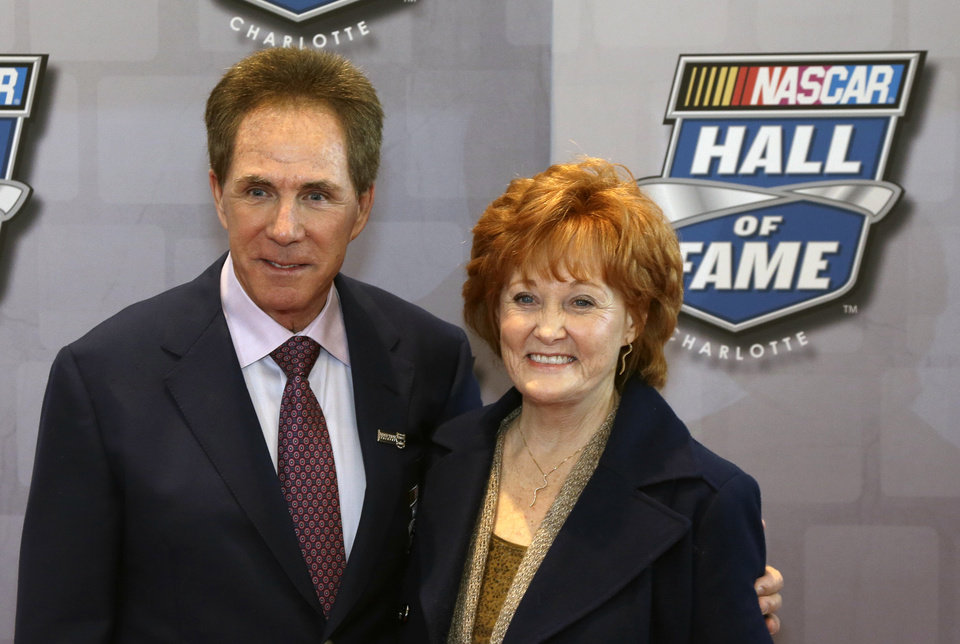 Photo - Darrell Waltrip poses for photographers  with his wife, Stevie on the red carpet at the NASCAR Hall of Fame before the start of the Induction Ceremony, Friday, Feb. 8, 2013, in Charlotte, N.C. (AP Photo/Bob Leverone)