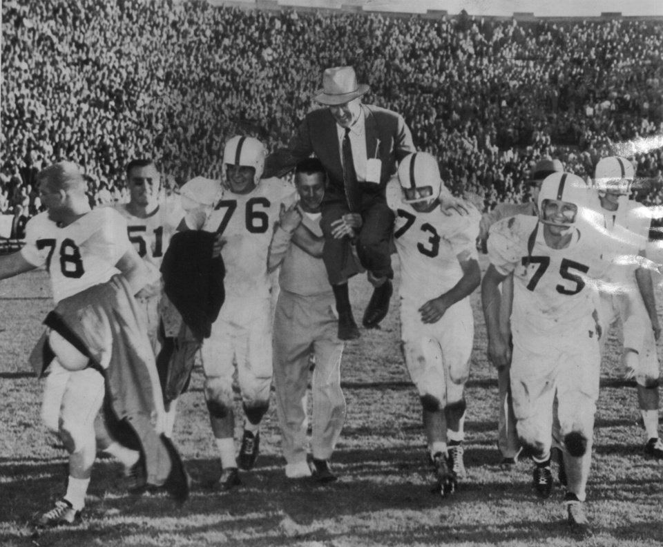 Photo - OU head football coach Bud Wilkinson is carried off the field after his 1956 Sooners defeated Notre Dame 40-0 in South Bend, Ind. Staff Photo by Special Wirephoto Transmission        (Original photo ran 10/28/56)