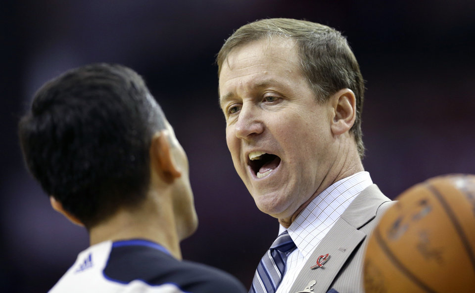 Photo - Portland Trail Blazers coach Terry Stotts, right, talks with official Zach Zarba, left, during a timeout in the second quarter of an NBA basketball game against the Houston Rockets, Sunday, March 9, 2014, in Houston. (AP Photo/David J. Phillip)
