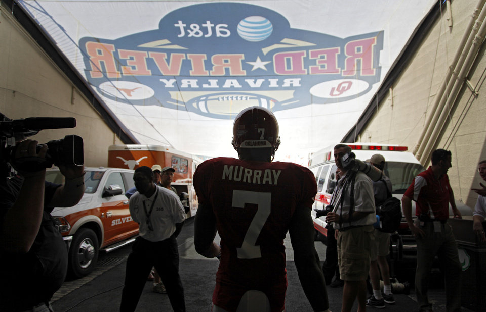 Oklahoma's DeMarco Murray (7) makes his way onto the field before the start of the Red River Rivalry college football game between the University of Oklahoma Sooners (OU) and the University of Texas Longhorns (UT) at the Cotton Bowl on Saturday, Oct. 2, 2010, in Dallas, Texas.   Photo by Chris Landsberger, The Oklahoman