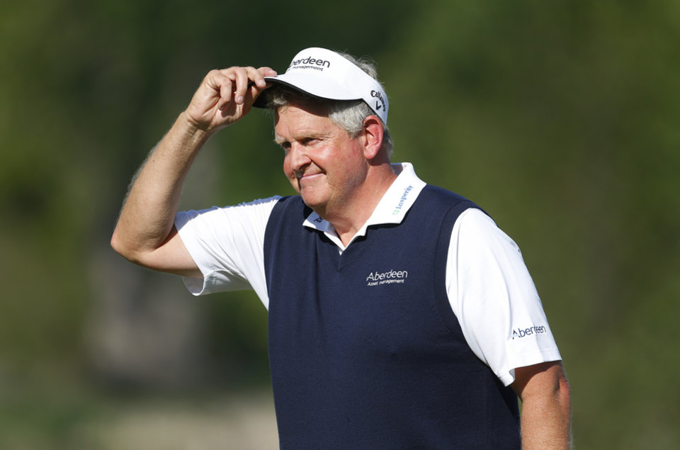 Colin Montgomerie tips his hat to the gallery on the 18th hole during the final round of the 75th Senior PGA Championship golf tournament at Harbor Shores Golf Club in Benton Harbor, Mich., Sunday, May 25, 2014. Montgomerie won with a 6-under 65 for a four-stroke victory over 64-year-old Tom Watson. (AP Photo/Paul Sancya)